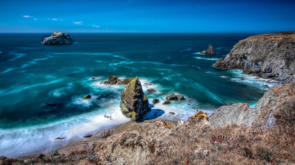Bodega Bay coastline on a blue sky cloudless day long exposure landscape Wall mural