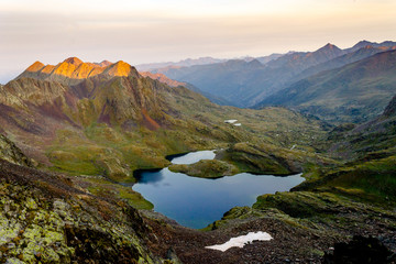 Wall Murals Deep brown Panoramic View of Lake Amidst Mountains at Sunrise