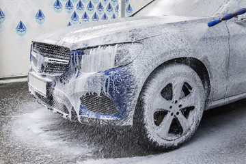 Washing car with soap. Close-up concept.
