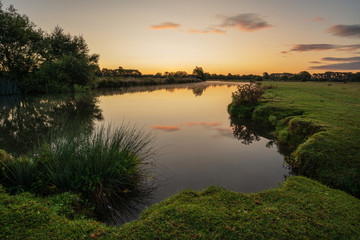 Beautiful dawn landscape image of River Thames at Lechlade-on-Thames in English Cotswolds countryside Wall mural