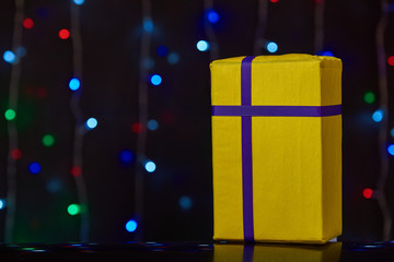 gorgeous yellow design box for gifts on colorful background