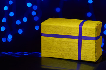 gorgeous yellow design box for gifts on bokeh background