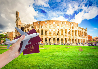 Plane travel concept, hand holding passports with plane isolated on white background Fototapete