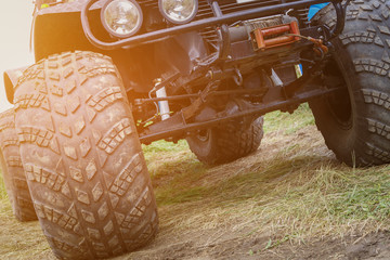 Wheels, automotive frame, springs and transmission of a large offroadster