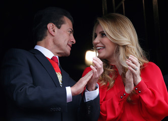 Mexico's President Enrique Pena Nieto and first lady Angelica Rivera chat during a military parade to celebrate Independence Day in Mexico City