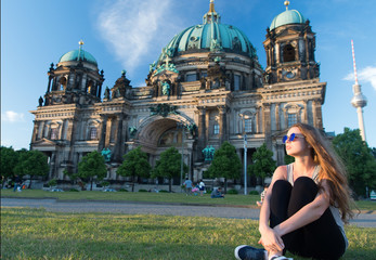 Foto op Plexiglas Berlijn thoughtful girl tourist sitting in germany near berlin cathedral. berlin cathedral view in germany with sitting girl. building tomorrow world today. travel around europe. life is awesome.