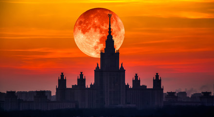 Moon collage of evening view of main building of Moscow State University