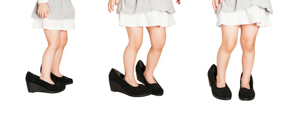 Set from portraits of little baby girl shod in women's shoes isolated on a white background.