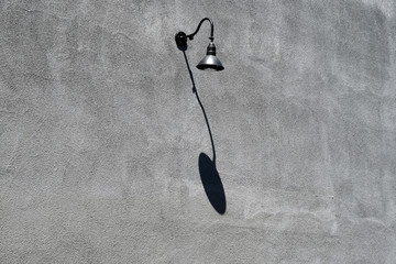 Lamp on a grey outside wall