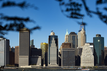 Amazing view of the Manhattan skyline seen from the Brooklyn Bridge Park. Sunny day of October in New York. USA.