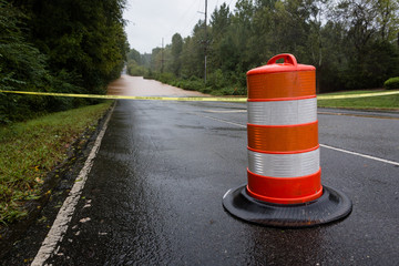Waxhaw, North Carolina - September 16, 2018: Police barricade the road after a bridge is washed out by rain from Hurricane Florence