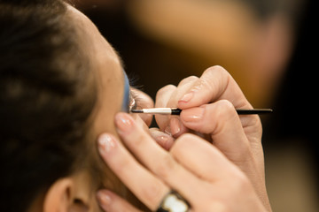 Young women doing makeup , old-fashioned. Backstage.
