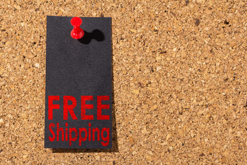 Cork panel. Red thumbtack, black paper: Black Friday concept. Text: Free Shipping