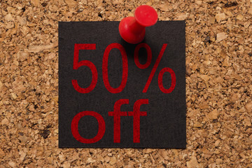 Mural message. Reminder of Black Friday. Red thumbtack. text: 50% off