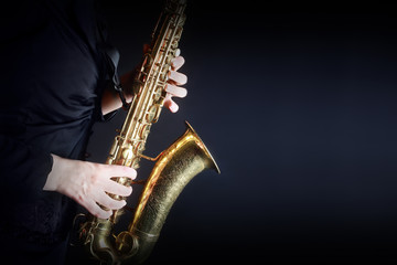 Foto op Plexiglas Muziek Saxophone Player Saxophonist playing jazz music. Sax player hands
