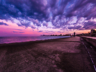 Chicago, IL - May 9th 2018: People flock to the lakefront to catch the gorgeous sunset over the Chicago skyline after earlier storm clouds drift out across the water.