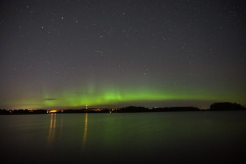Night sky with northern lights at the lake