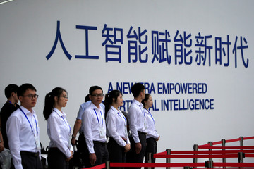 Security officers stand guard at the World Artificial Intelligence Conference (WAIC) in Shanghai