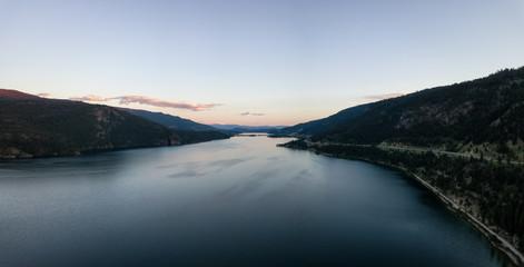 Aerial panoramic view of Kalamalka Lake during a vibrant summer sunset. Located near Kelowna and Vernon, BC, Canada.