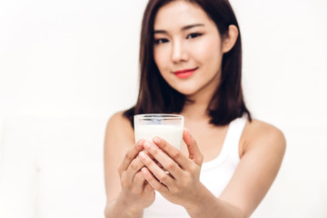 Woman hands holding glass of fresh milk