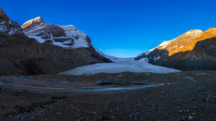 Scenic view of the sunrise over the Athabasca Glacier in the Jasper National Park, Alberta, Canada