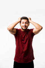 unhappy Indian/asian young man suffering from head ache. isolated over white background. people, crisis, emotions and stress concept