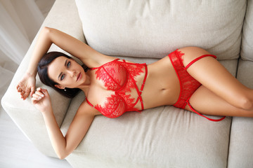 sexy woman with dark hair in red lingerie