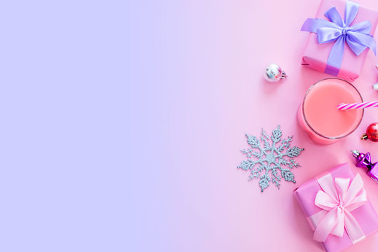Festive background for text composition flat lay Christmas items gift box ribbon bow pink glass cocktail Christmas toys Top view copy space