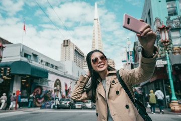 woman taking selfies with a famous building