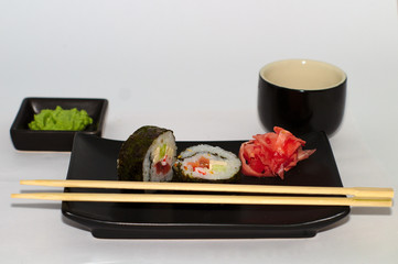 isolated sushi on a plate with wasabi and soy sauce