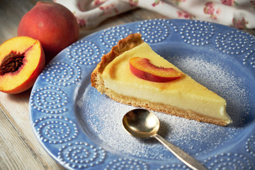 Cottage cheese casserole with sour cream on white plate. Cottage cheese baked pudding peach