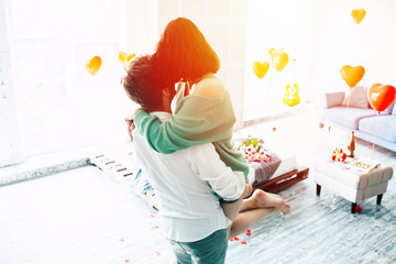 Couple in love. Stylish beautiful man and woman is dancing in bedroom with romance background