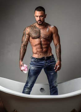 Muscular athletic sexy male with naked torso. Man with tattooed body. Confident and handsome Brutal man. Mens health. Beautiful male torso.