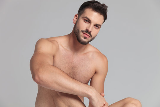 portrait of a sexy naked seated man