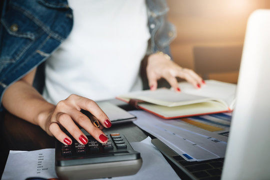 businessman working with calculator and digital tablet computer with financial business strategy layer effect in office, bookkeeper and auditor concept.