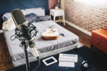 bedroom studio. home recording studio. microphone, musical instrument and recording equipment in bedroom