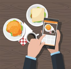 Mobile photography concept. Man taking photos of hamburger and cup of coffee on the smartphone