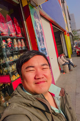 selfie Photo of Asian fat man traveler on the street in yiwu city china