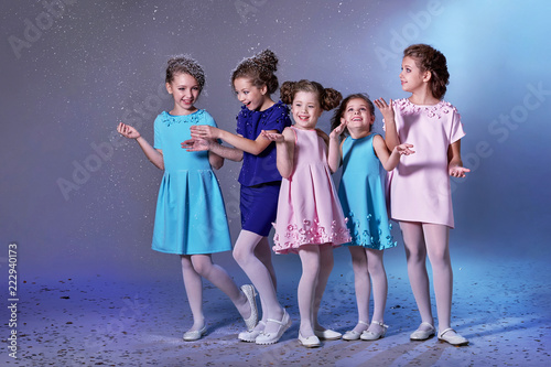b4d7c220a07f Group happy children in celebratory clothes for lady girls. Concept ...