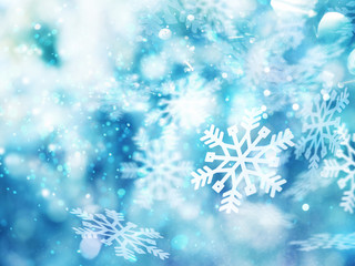 Abstract glowing Christmas blue background with snowflakes