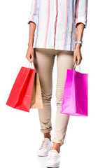 cropped view of woman holding shopping bags isolated on white