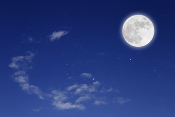 Romantic night with full moon in space over stars with cloudscape background.