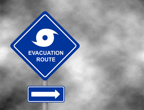 Warning evacuation route road. Hurricane season with symbol sign against a stormy grey sky background. Vector illustration.