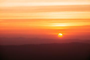 Dramatic sunset and sunrise over mountain morning twilight evening sky. Fotobehang