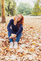 Attractive young redhead woman with a sweet smile