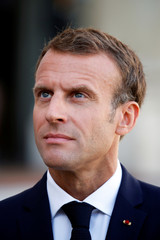 French President Emmanuel Macron talks to journalists before a meeting at the Elysee Palace in Paris