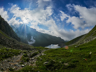 Mountain landscape, Capra Lake, Fagaras mountains, Romania at sunrise
