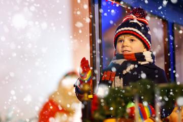 Canvas Prints Fairytale World Little kid boy on carousel at Christmas market