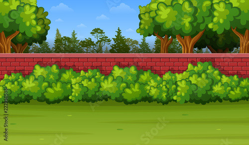 Garden Background With Brick Wall And Green Grass Stock Image And