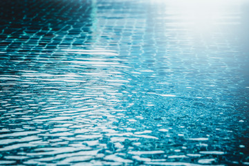 Abstract background of water wave in swimming pool.